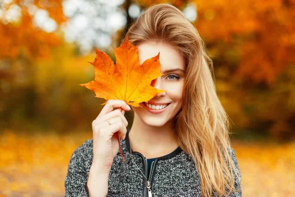 Woman keeping hair healthy in autumn.